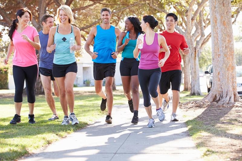 Group Of Runners On Suburban Street